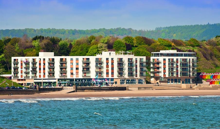 An exterior image of The Sands Seafront Apartments
