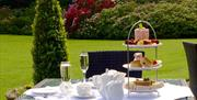 An image of afternoon tea in the gardens at Wrea Head Hall Country House Hotel