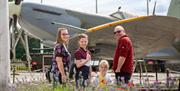 A family in front of an airplane at Eden Camp Modern History Theme Museum in East Yorkshire.