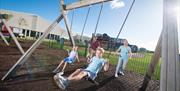 Outdoor children's play area at Cayton Bay Parkdean Resort.