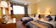 An image of The Crescent Hotel twin bedroom