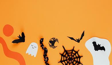 Halloween paper craft on orange background