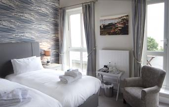 An image of a White Lodge Hotel bedroom
