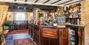 An image of the bar at The Royal Oak Inn