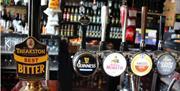 An image of the bar at White Horse Farm Inn