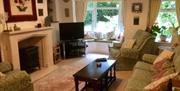 An image of the living room at Woodside Cottage