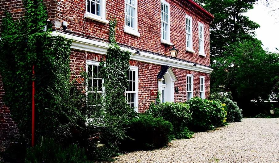 An exterior image of Wrangham House Hotel