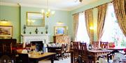 An image of the dining area at Wrangham House Hotel